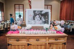 Use what you have.  To save space and time we used this buffet table that was already in the restaurant to display the rice cake party favors. Also make it a little more personal by adding the First year summary poster of the birthday child!  Coordination and decorations by: Sky Meadow Place Photo credit: Beautiful Harvest  #koreanfirstbirthday #dohl #dol #korean tradition #ohtheplacesyou'llgo #drsuess #orange #pink #fuschia #turquoise #yellow  #firstyearposter #ricecake #partyfavors