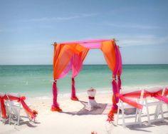 Suncoast Weddings Florida beach wedding magic! Orange and fuschia chiffon to make your dream day the ultimate in style!