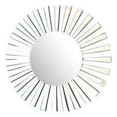 """Lend a touch of eye-catching appeal to your entryway or master suite with this stylish wall mirror, showcasing a sunburst-inspired design and round silhouette.    Product: Wall mirrorConstruction Material: Wood and mirrored glassColor: Silver frameFeatures: Sunburst-inspired designRound silhouette  Dimensions: 31.5"""" Diameter x 0.75"""" D  Cleaning and Care:  Dust all non-mirror surfaces with a dry, soft, cloth, clean mirrored surfaces with glass cleaner"""