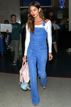 Photo via: Harper's Bazaar Model Lily Aldridge was spotted at the airport yet again in a crazy cool off-duty look. This outfit in particular was comprised of a white long sleeve off-the-shoulder top,
