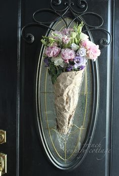 FRENCH COUNTRY COTTAGE: DIY Wire flower basket... chicken wire shaped to how you would like (cone, square, etc) brown paper or your choice of paper to wrap around the bouquet a little jar (or plastic cup if using on a glass door) to tuck inside for water for the flowers & a bouquet of favorite flowers