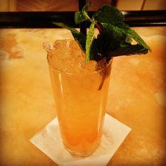 "From Luke Ramos at Ste. Ellie in Denver: ""Honey Bear's Bikini Drop"": 1oz El Dorado 3 Year Rum 1oz El Dorado 5 Year Rum .5oz R&W Orchard Pear Liqueur .5oz Aperol  1oz fresh Pineapple juice 1oz fresh Lime juice .75oz 1:1 Honey Syrup  Build in Collins glass, add pebble ice, swizzle, garnish with freshly grated nutmeg and a healthy sprig of mint. Spring textures with orchard fruit and some flavors reminiscent of Winter. #DrinkElDorado #Denver #friendsinhospitality #rumstagram"