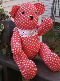"""PH-052 - Fabric Teddy Bear - """"Victoria"""" Victoria is a 15 inch bear when standing and is made in red cotton with small white hearts. She has a lace collar trimmed with a brooch. Her arms and legs are movable button jointed and her nose and mouth are hand stitched with embroidery floss. Eyes are buttons. Handcrafted in the USA, each handmade bear is signed and dated by artist. $44.00 + S/H ea. NOT RECOMMENDED FOR CHILDREN UNDER THE AGE OF 3. **FREE SHIPPING EXPIRES DECEMBER 1ST, 2016**"""