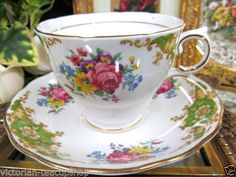 COLCLOUGH TEA CUP AND SAUCER FLOWERED PATTERN TEACUP <br/>Cups & Saucers - 63525