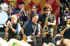 """Bruce Springsteen and the horn section of the E Street Band paid homage to New Orleans with an extended version of """"When the Saints Go Marching In."""""""