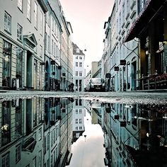 """When Morten Nordstrøm (@Morten Nordstrøm) isn't working or studying, he's out showcasing the beauty of Copenhagen, Denmark, as reflected through the city's many puddles. Getting the most out of a puddle's reflection is an art, and Morten offered these tips for capturing and editing a #puddlegram on a Nokia Lumia 925 Windows phone:  When it comes to puddles, """"the bigger the better. I look for a strong central focal point and try to get some depth in the perspective. That's one of the reasons…"""