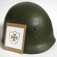 "WW2 65th Infantry Regiment ""The Borinqueneers"" Helmet Stencil.   This is the only stencil for ""The Borinqueneers"" worn in WW2. They are a Puerto Rican regiment of the United States Army. The regiments motto is Honor et Fidelitas, Latin for Honor and Fidelity. The 65th Infantry Regiment participated in World War I, World War II and the Korean War & still serve today. This the WWII version of the stencil worn on the front of the helmet.  WWW.WarHats.com"
