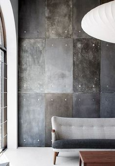 Make your own concrete-effect feature wall using cement fibre board with plaster and paint finish techniques.