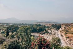 A view of ancient Ephesus and the surrounding areas from the Terrace Houses. Click here for a full one day itinerary for visiting the ancient ruins of Ephesus in Turkey here. #ephesus #turkey #travel | Biblical places to visit | Biblical places in Turkey | Ephesus photography | Ephesus Turkey travel | Ephesus Bible | Library of Celsus Ephesus | Ephesus library | ancient Ephesus | Ephesus ruins | Things to do in Ephesus Turkey | Ephesus travel tips | Ephesus Turkey ruins Asia Travel, Solo Travel, Travel Tips, Ephesus, Turkey Travel, Ancient Ruins, Beautiful Places In The World, Travel Couple, Summer Travel