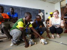 """Competition in Liberia""  By: Elizabeth McBride.  Caption: ""Students in the Excellence in Higher Education for Liberian Development (EHELD) program built cars throughout a one-week period and competed in a distance competition against each other.""  Category: Wolverines Abroad.  Program: EHELD in Liberia."