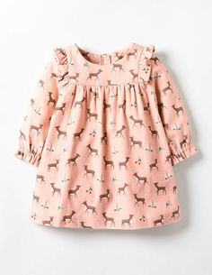 Ta-da – with its sweet ruffles for extra prettiness, this dress is just made for big days out with the family. The long sleeves and full lining keep it oh-so cosy for baby (a must during chilly afternoons), and it's machine washable – perfect for those unavoidable little spills and dribbles. Choose between roaming fawns on 100% cotton corduroy, and colourful checks on pure brushed cotton.
