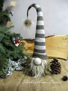 Large Christmas gnome of light khaki and light gray wide stripes made from wonderful faux fur and sweater in Nordic and Scandinavian style will be wonderful decor for you own Christmas decoration and a great gift for winter holidays or housewarming. You can put it on the floor next