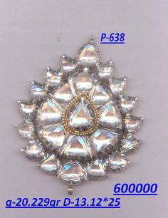 Pachchikam pendent haste been made with fine table cut diamond and white gold metireal.