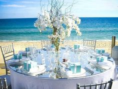 fabulous summer beach wedding colors with matched bridesmaid dresses. what are the advantages having a beach wedding too much! most beach wedding themes are tend to be typically romantic and cozy, no. Beach Table Decorations, Beach Wedding Centerpieces, Wedding Reception Decorations, Wedding Themes, Wedding Ideas, Flower Centerpieces, Centerpiece Ideas, Reception Table, Decor Wedding