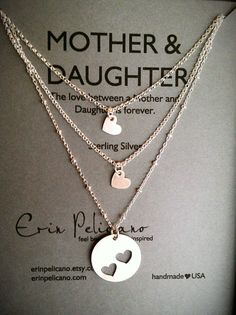This would work perfectly in adoption.  give the child the large charm and give adoptive and bio mom the small heart charms.  Mother Two Daughters Necklace Set // Inspirational Jewelry // Simple Delicate
