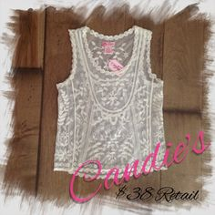 Candie's | Embroidered Crochet Tank Top XS Lace This adorable juniors' Candie's embroidered crocheted tank top will look lovely with your favorite white cami and skinny jeans.  PRODUCT FEATURES Lace & embroidered floral details Scoopneck FABRIC & CARE Cotton, nylon Machine wash Imported Candie's Tops Tank Tops