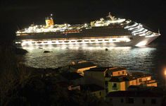 The luxury cruise ship Costa Concordia leans after it ran aground.