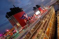 Tips on Taking a Disney Cruise: Tips for embarkation: carry on for 1st day, check in online, p/u personal navigator at guest services Tips for Packing: bring a case of water, byo alcohol, byo travel mug for refills, bring a coat, swim shoes?