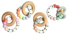 Cutting teeth has never been sweeter than when chomping on a lush silky silicone bead teething toy showcasing baby's very own moniker! A sweet practical gift for the babe in your life, a silicone bead and beech teether ring is given a unique and special