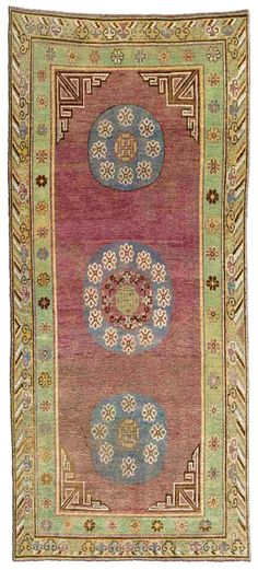 A Samarkand carpet BB4371 - A second quarter 20th century Samarkand carpet, the purple field with a column of three blue roundels, each contain ...I've shown this piece before and I am crazy about this color combo...wouldn't it be great in a primarily blue and white designed room? Just to add that twist and keep things from getting too set?