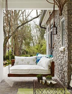 Rustic back porch swing and cozy pillows...