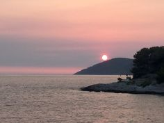 Sunset in Croatia. The Sun was actually a brilliant red as we went behind the hills.
