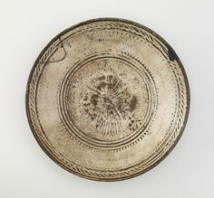 Buncheong Bowl, interior view. Joseon period, second half of 15th-first half of 16th century.  Chungcheongnam-do province, Gyeryongsan kilns. Stoneware with white inlay under clear glaze; silver lacquer repairs. 6.0 x 20.8 cm. Freer Gallery of Art