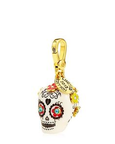 """LIMITED EDITION SUGAR SKULL CHARM Detailshttp://m.juicycouture.com/Limited-Edition-Sugar-Skull-Charm/098686434929.html WAS $58.00 / NOW $39.99 Final Sale Promotions Take 30% Off Sale Jewelry DETAILS STYLE YJRU7232  DESCRIPTION Mardi Gras is right around the corner. OK fine…it's not, but this skull charm is at the top of our to-wear list. Juicy logo on lobster clasp. Gold tone. 0.9"""" L X 0.9"""" W X 1.9"""" H Imported Czw/Brass/Glass/Epoxy/Formica"""