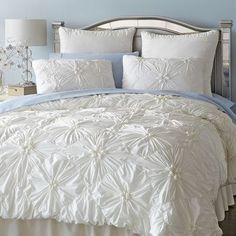 Our ruched ivory bedding gathers crisp cotton in a pattern of flowers on a field of diamonds. Inside ties at all four corners keep your duvet from shifting, while shams feature tie backs and decorative welting. The ruche is on. Ivory Duvet Cover, Ivory Bedding, Duvet Bedding, Bedding Sets, Bedroom Comforters, Cotton Bedding, Home Bedroom, Master Bedroom, Bedroom Decor
