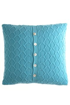 Sweater pillow. I've seen this in a magazine before, and I so want to make some.