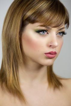 Cat eyes make up look using different green shades on the eyes and bold black liner. Make Up by ReginaInNeverland