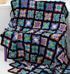 Art deco kaleidoscope crocheted afghan multi-colored with black border