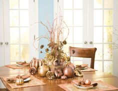 Thanksgiving--i'm not so into the glizty gold, but love the height and shape given of the tablescape.