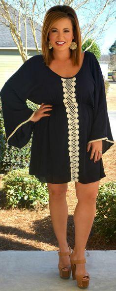 Perfectly Priscilla Boutique - The Ditsy Daisy Dress, $50.00 (http://www.perfectlypriscilla.com/the-ditsy-daisy-dress/)