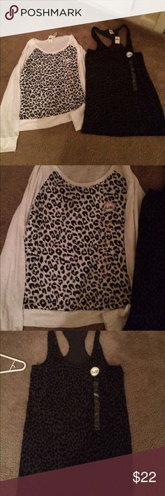 Victoria secrets shirts 2 new with tags Victoria Secret shirts, both large, with tags and stickers still attached. Victoria's Secret Tops