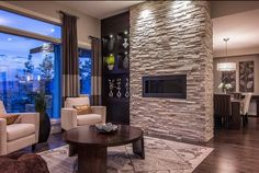 Dark cabinets with medium tone floor and our fireplace!  Fantastic Contemporary Living Room Designs