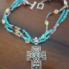 Reduced!!!!Awesome turquoise cross choker necklace This beautiful piece is detailed with blue & green turquoise, yellow Citrine and Garnet also peach colored stones/beads which I don't remember what they are. Necklace measures 16' long end to end with toggle clasp , cross measures 2 1/2' long including bail 1 1/2' wide and 1/4 thick. Outstanding piece just to snug on me and been sitting in my jewelry box way too long weighs 108.76 grams Jewelry Necklaces