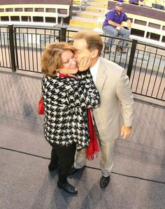 A kiss for Mrs.Terri from her favorite Coach; Nick Saban