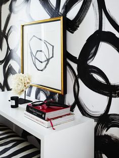 Black paint on wall with framed black and white art.