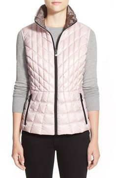 Free shipping and returns on Bernardo Quilted Down & PrimaLoft® Vest (Regular & Petite) at Nordstrom.com. A cold-weather vest stays slim and trim thanks to a technically innovative blend of compressible down and PrimaLoft insulation. A strategic mix of quilting and a defined waist seam further the flattering effect.