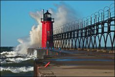 South Haven Pier. Gale force winds pound the South Haven, Michigan lighthouse. by Tom Gill