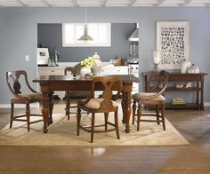 Contemporary Dining Room with Crown molding, Box ceiling, Surya Shibui Tan Rug, Vintage Dining Table, Mineral Deposit Paint Color: SW 7652