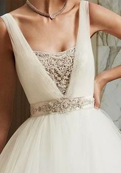 Gorgeous wedding dress neckline detailing - love the beaded sash belt  http://www.pinterest.com/JessicaMpins/