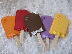 Sweet Popsicle Scrapbooking Embellishments...made from colorful dotted swiss papers  using popsicle craft sticks.