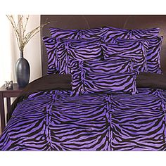 @Overstock - Add a playful touch to your bedroom decor with this 3-piece purple and black zebra print comforter set from Thro. This super soft microplush comforter is reversible so you can easily change up the look of your room.  http://www.overstock.com/Bedding-Bath/Zebra-Purple-Microplush-Reversible-3-Piece-Comforter-Set/6387526/product.html?CID=214117 $99.99