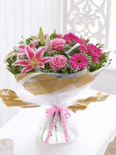 Featuring pink Oriental lily, pink large-headed roses, cerise germinis and pink lisianthus, hand-tied with gypsophila, aspidistra leaves, eucalyptus and salal. Trimmed with a Thank you ribbon and presented in gift packaging. Order Flowers Ireland