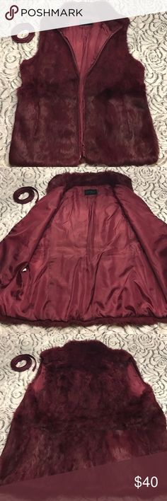 Express furry vest with belt This is an exquisite fully lined, fur vest by Express in a deep purple-red hue. Feels silky soft to the touch and comes with belt. There is a tear on the front R along the zipper. Can be glued or mended but concealed. Express Jackets & Coats Vests