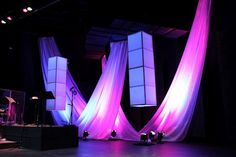 Draped white fabric, lanterns covered in tissue paper for texture . Stage Set Design, Church Stage Design, Bühnen Design, Event Design, Wall Design, Hanging Fabric, Stage Decorations, Scenic Design, Stage Lighting