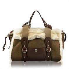 The UGG Australia Scout Shearling Doctor Bag Satchel.  I would like to wear this purse every time it snows.  It just looks like a purse that can HANDLE the snow.