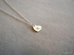 Tiny Sterling silver Heartbeat necklace. $14.99, via Etsy.
